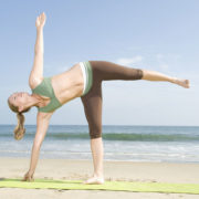 Woman Practicing Physical Yoga
