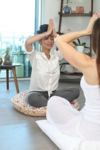 Two person doing meditation with cushion