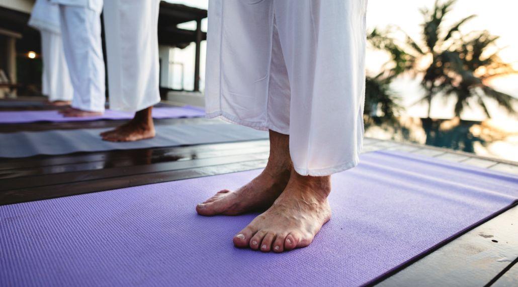 Yogi standing on a yoga mat