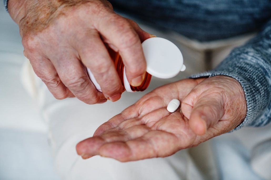 Person holding medication tablets