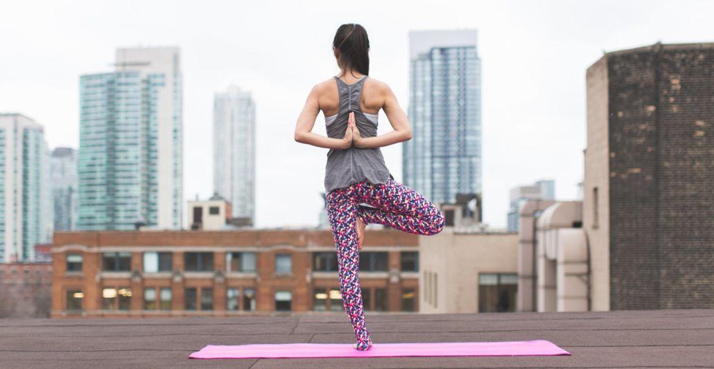 Woman standing on pink yoga mat