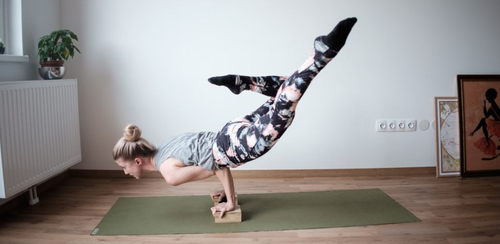 Woman performing yoga with blocks
