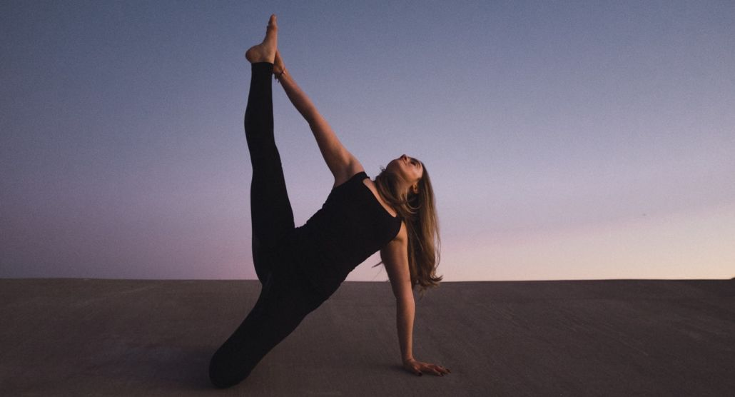 Woman in black stretching